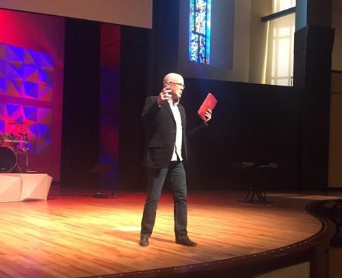John preaching during chapel at IWU